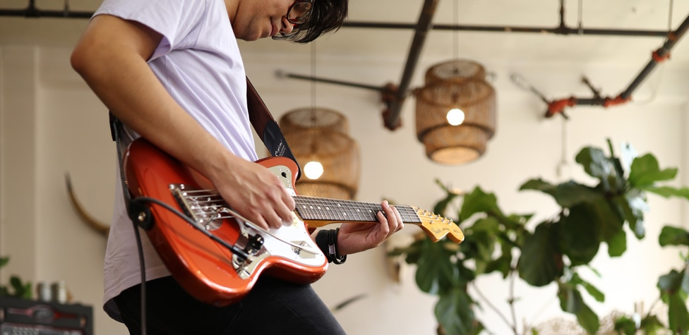 Ryan Silo playing his Fender Johnny Marr Jaguar electric guitar