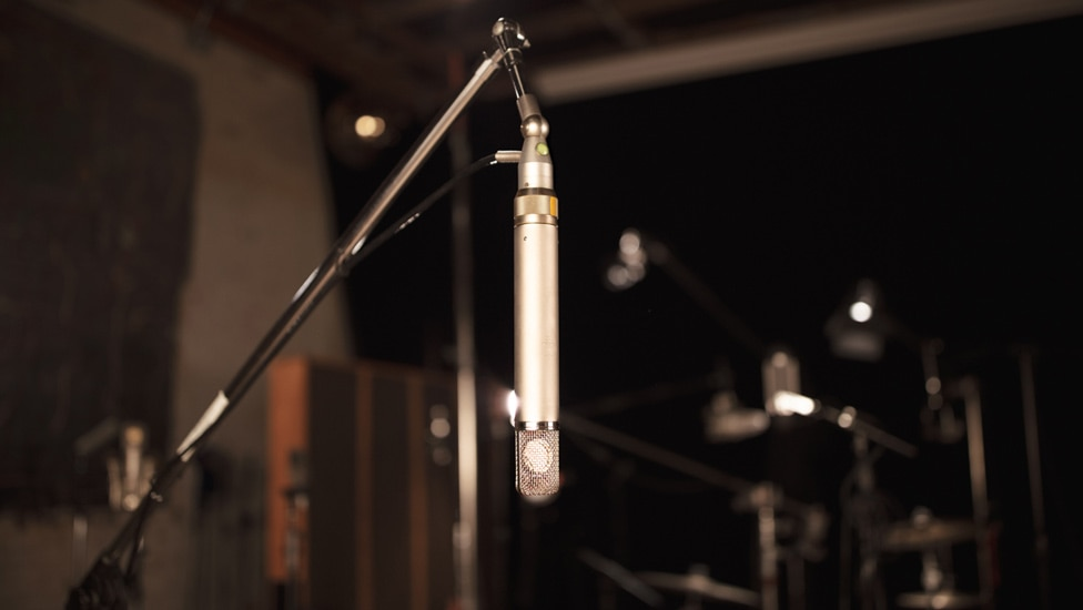A vintage AKG C12 makes a great room microphone for drums.